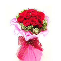 12 Red Roses in Bouquet with Greenery.